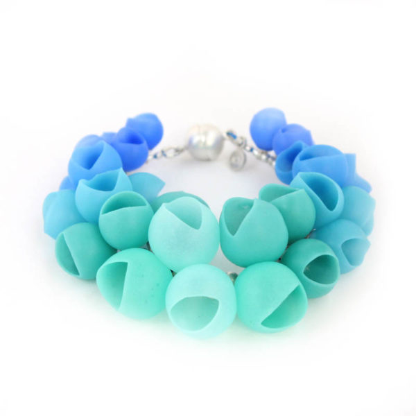 Plume bangle, jenny llewellyn, silicone jewellery, silver, blue green fade