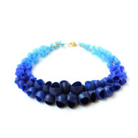 plume graduating cluster necklace gold navy fade